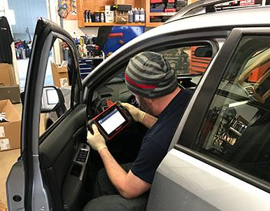 Employee running a diagnostics test on the car